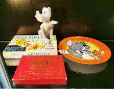 A Tom and Jerry limited edition plate, ceramic cartoon dog and two games.