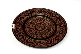An unusual Chinese two colour carved cinnabar lacquer charger, Dia. 35cm.