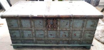 An iron bound heavy Indian hardwood trunk, 111cm x 64cm x 51cm.
