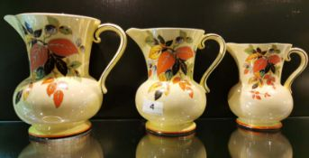 A set of three 1930's Falconware ceramic jugs, largest 20cm.