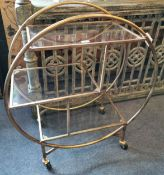 A vintage style gilt metal and glass drinks trolley, W. 82cm x H. 93cm.
