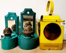 Two painted wall mounted tin oil lamps and a vintage metal roadworkers lamp, wall lamp H. 24cm.