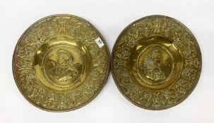 A pair of early German hammered brass alms bowls, Dia. 37.5cm. Condition report : Minor splits and