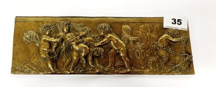 A 19th Century French bronze panel decorated with Putti, 27.5 x 9cm.