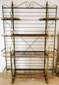 A superb large gilt brass painted metal and glass baker's rack shelving unit, W. 148cm x H. 220cm.