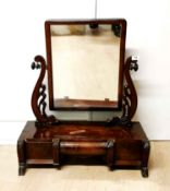 An early 19th C. mahogany veneered dressing mirror with three drawers, H. 74cm.