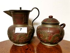 An early 20th C. Chinese pewter overlaid Yixing terracota jug, H. 14cm, together with a matching