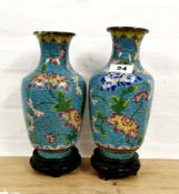 A pair of Chinese clossoine vases on copper, mid 20th C. decorated with flowers on a blue cloud
