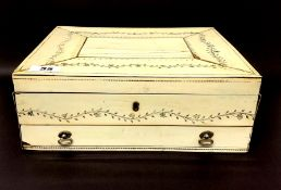 An early 19th Century white metal (tested silver) mounted Anglo-Indian ivory covered wooden workbox,