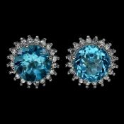 A pair of 925 silver stud earrings set with swiss cut blue topaz surrounded by white stones, Dia.