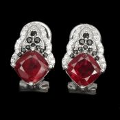 A pair of 925 silver earrings set with cushion cut rubies and black spinels, L. 1.7cm.
