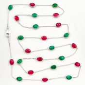 A 925 silver necklace set with emeralds and rubies, L. 90cm.