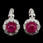 A pair of 925 silver drop earrings set with cabochon cut rubies and white stones, L. 1.5cm.