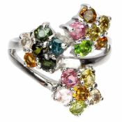 A 925 silver flower shaped crossover ring set with mixed colour tourmalines.