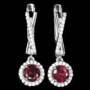 A pair of 925 silver drop earrings set with round cut garnets and white stones, L. 2.3cm.