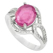 A 925 silver ring set with an oval cut rubi and white stones, (P).