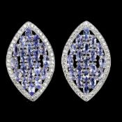 A pair of 925 silver earrings set with tanzanites and white stones, L. 2.5cm.