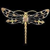 A 925 silver gilt dragonfly shaped brooch / pendant set with rodolite garnets and peridots, 8.3 x