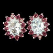 A pair of 925 silver cluster earrings set with oval cut aquamarine surrounded by rodolite garnets,