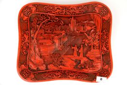 A large Chinese cinnabar type plate, 37 x 31cm.