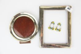 Two hallmarked silver photo frames, largest 17x22cm, together with a pair of enamelled miniature 925