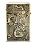 A superb Chinese hallmarked silver card case decorated with dragons and chrysanthemums, 11 x 7cm.