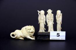 An early 20th C carved figure of a lion (a/f to one leg) together with three early 20th C Chinese
