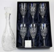 A boxed set of six Stuart crystal wine glasses together with a cut glass decanter.
