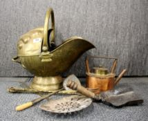 An Art Nouveau hammered brass coal bucket and other fire side items.
