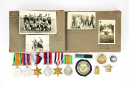A collection of medals and an associated photograph album.