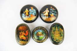 A group of five Russian hand painted papier mache and metal boxes boxes, largest 8cm.