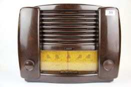 A vintage Bakelite radio, 38 x 34cm.