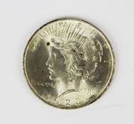 A United States 1923 one dollar coin.