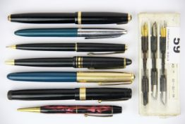 Two fountain pens with 14ct gold nibs, a quantity of pens and pencils and a box of replacement
