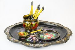 A Russian hand painted tin tray, small platter and a painted bowl and six wooden spoons, tray