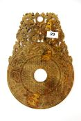 A Chinese archaic form carved jade/hardstone Pi disk, mounted with dragons, 32.5 x 23cm.