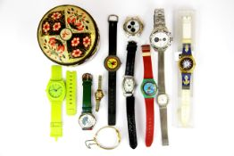 A tin of mixed wrist watches.