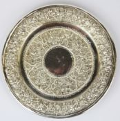 A Persian hammered white metal (tested silver) dish, approx. 153gr, Dia. 16cm.