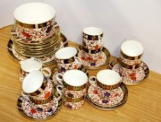 A very extensive Royal Crown Derby tea set, including 11 cups and saucers, 12 side plates, two