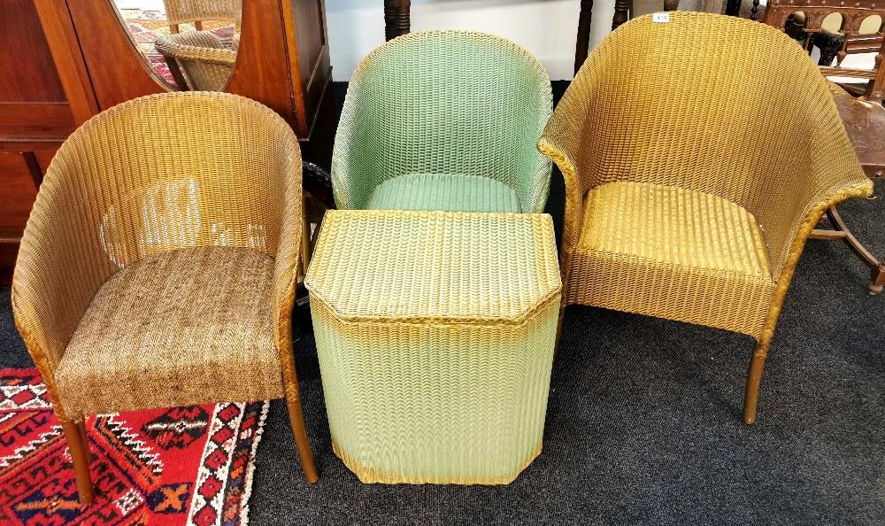Two Lloyd Loom chairs and Lloyd loom linen basket.