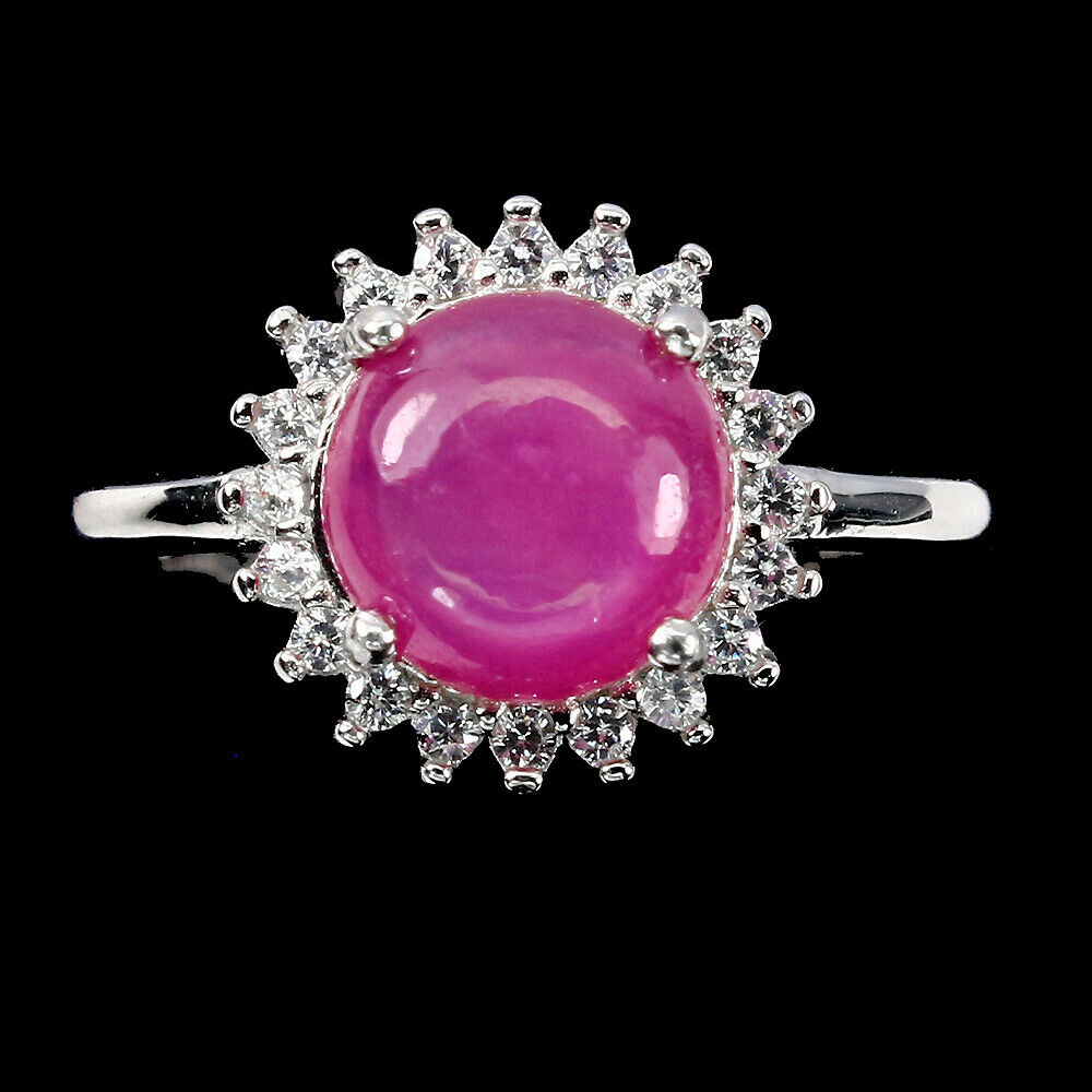A matching 925 silver ring with a cabochon cut ruby and white stones, (M.5).