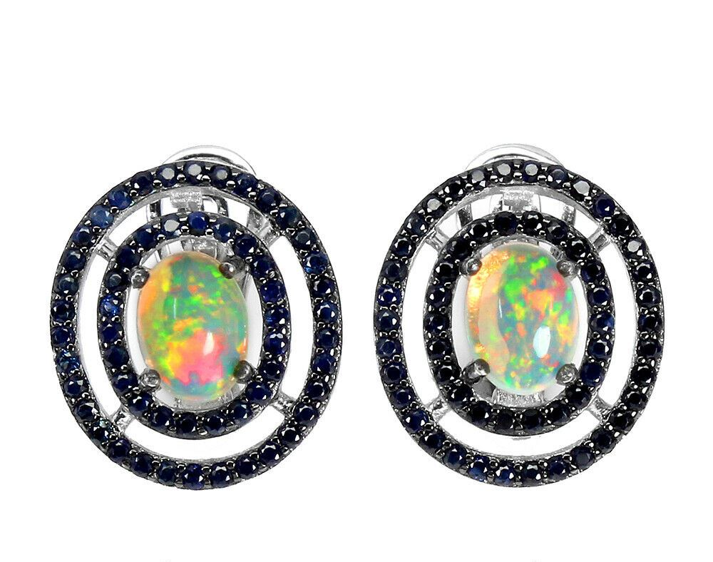 A pair of 925 silver cluster earrings set with cabochon cut opal and sapphires, L. 1.7cm.