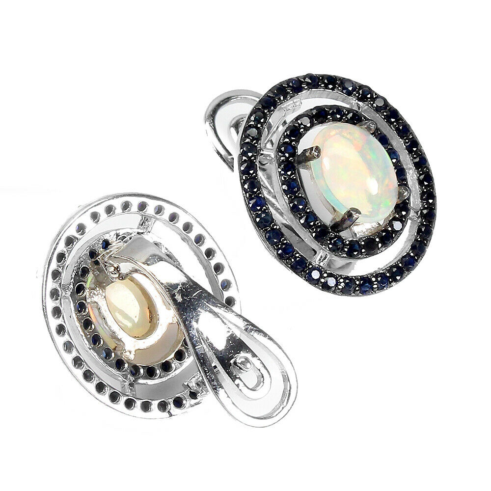 A pair of 925 silver cluster earrings set with cabochon cut opal and sapphires, L. 1.7cm. - Image 2 of 2