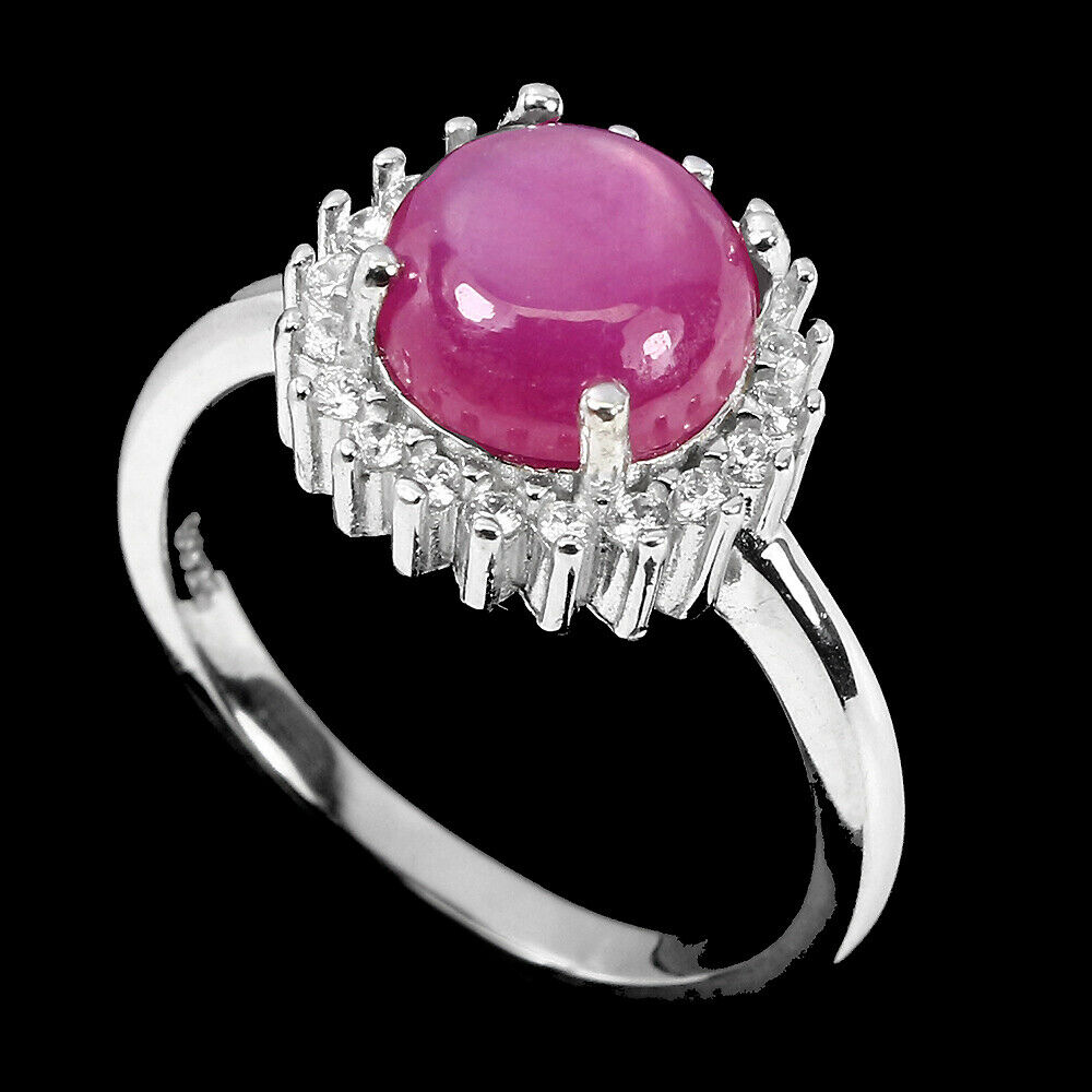 A matching 925 silver ring with a cabochon cut ruby and white stones, (M.5). - Image 2 of 2