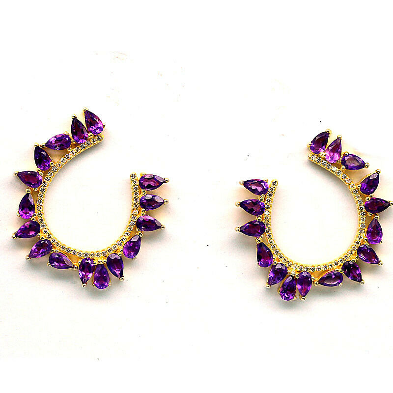 A pair 925 silver gilt earrings set with pear cut amethysts and white stones, L. 3cm.