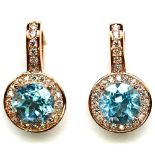 A pair of 925 silver rose gold gilt earrings set with sky blue topaz and white stones, L. 2cm.