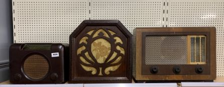 A vintage bakelite radio with a wooden cased speaker and a further GEC radio.