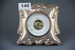 An Art Nouveau hallmarked silver fronted desk barometer, 14 x 13cm.