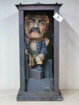 An interesting vintage painted ceramic figure of a pirate in a handmade copper case, H. 43cm.