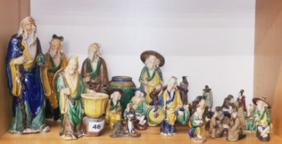 A group of Chinese glazed pottery figures, tallest 24cm.